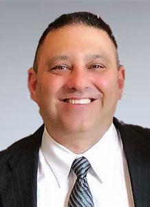 Dr. Michael Presi